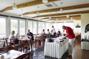 Restauracja lub miejsce do jedzenia w obiekcie Galeria Pępowo