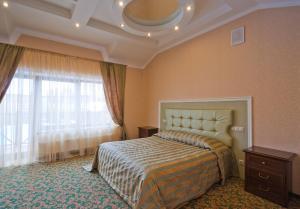 Кровать или кровати в номере Hotel Temernitskiy