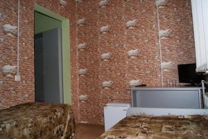 Телевизор и/или развлекательный центр в Гостиница Лебедь