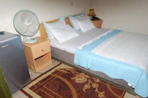 A bed or beds in a room at Step Town