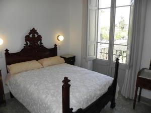 Cama o camas de una habitación en Hostal Cal Pla