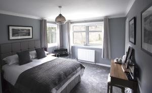 A bed or beds in a room at The Corries B&B
