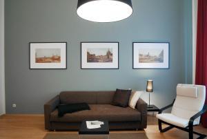 Ein Sitzbereich in der Unterkunft Aparthotel am Zwinger