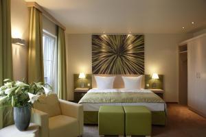 Ein Bett oder Betten in einem Zimmer der Unterkunft Kur und Wellnesshaus Spreebalance, The Originals Relais (Relais du Silence)