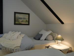 A bed or beds in a room at Rosindell cottage