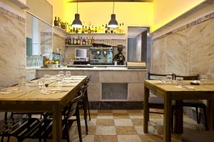 A restaurant or other place to eat at Santa Bica Eat Drink & Sleep