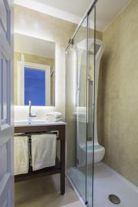 A bathroom at 3 Sixty Hotel & Suites