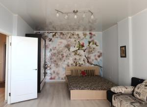 Кровать или кровати в номере Revolyutsii Apartment