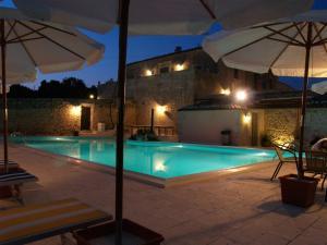 The swimming pool at or near Casina Di Grotta Di Ferro