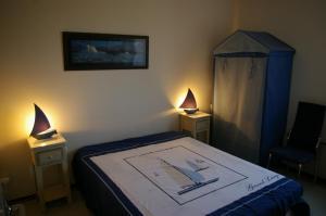 Un ou plusieurs lits dans un hébergement de l'établissement LeWindy Barcares