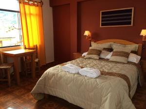 A bed or beds in a room at El Jacal Classic