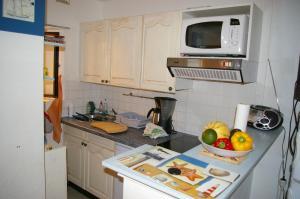 Cuisine ou kitchenette dans l'établissement LeWindy Barcares
