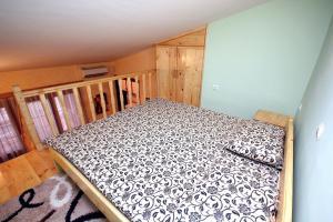 Postelja oz. postelje v sobi nastanitve Apartment Djordjije