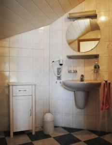 Ein Badezimmer in der Unterkunft Gasthof-Hotel-Löwen