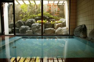 The swimming pool at or near Nakaya Ryokan