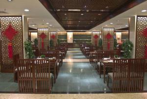 مطعم أو مكان آخر لتناول الطعام في فندق قوانغتشو بايون