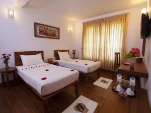 Ein Bett oder Betten in einem Zimmer der Unterkunft New Wave 1 Guesthouse