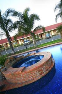 The swimming pool at or near Pines Country Club Motor Inn