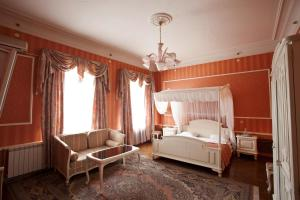 A bed or beds in a room at Sergievskaya Hotel