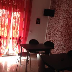Area soggiorno di Bed and Breakfast A.l.g.a