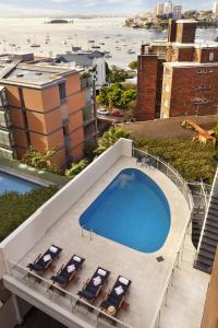 A view of the pool at Macleay Hotel or nearby