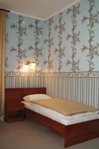 Кровать или кровати в номере Georgensvalde