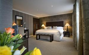 A bed or beds in a room at The Beaufort