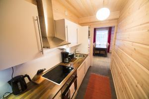 Majoituspaikan Ounasvaaran Lakituvat Chalets keittiö tai keittotila