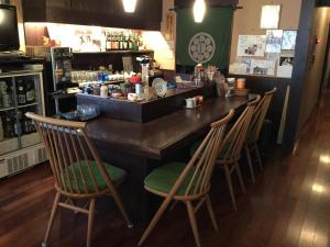 The lounge or bar area at Henmi Ryokan