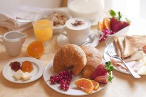 Opções de café da manhã disponíveis para hóspedes em Apostoli Palace