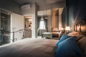 Letto o letti in una camera di Amiterno Home