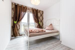 Ein Bett oder Betten in einem Zimmer der Unterkunft Apartment Köln Rath