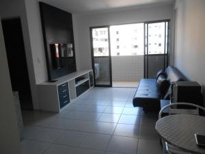Uma área de estar em Apartamento Monte Paradiso
