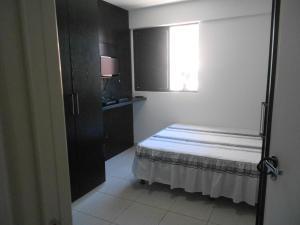 Cama ou camas em um quarto em Apartamento Monte Paradiso