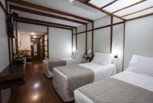 A bed or beds in a room at Hotel Nikko