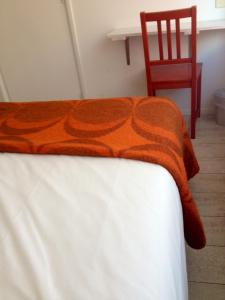 Een bed of bedden in een kamer bij Hotel B&B Altijd Wad