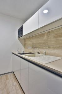 A kitchen or kitchenette at VIP Apartments