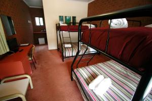 A bunk bed or bunk beds in a room at The Harrietville Snowline Hotel