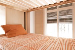 Cama o camas de una habitación en Chinitas Urban Hostel