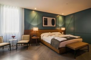 Een bed of bedden in een kamer bij Vincci Porto