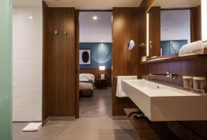 Een badkamer bij Vincci Porto