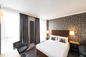 A bed or beds in a room at GoGlasgow Urban Hotel by Compass Hospitality