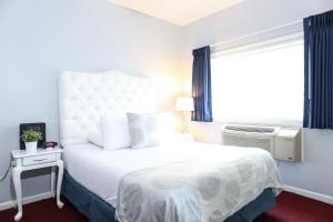 Un ou plusieurs lits dans un hébergement de l'établissement The Hotel Hollywood