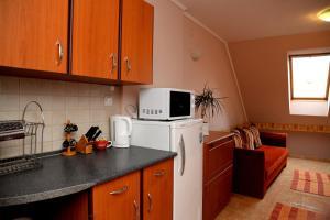 A kitchen or kitchenette at Abbázia Apartman