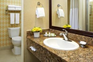 A bathroom at Portofino Inn and Suites Anaheim Hotel