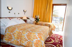A bed or beds in a room at Hotel Sindibad