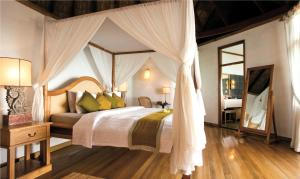 A bed or beds in a room at Coco Palm Dhuni Kolhu