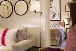 Cama o camas de una habitación en Balmoral Champs Elysées