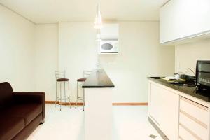 A kitchen or kitchenette at Flats Unicaflex
