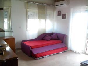 Letto o letti in una camera di Pozzo Lazzaro Apartments